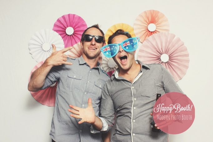 two guysfrom a band in a photo booth at a wedding in Byron Bay